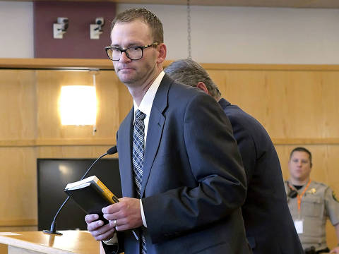 Adam Winger walks out of the courtroom after he was sentenced to 30 days in jail in 1st District Court Monday, Aug. 13, 2018, in Logan, Utah. Winger pled guilty to theft and forgery for stealing money while he was the director of the North Logan Library. Part of the negotiated plea settlement was an agreement to pay $78,000 in restitution in advance. (Eli Lucero/The Herald Journal via AP, Pool) ORG XMIT: UTLHJ101
