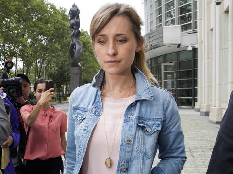 Actress Allison Mack, center, leaves Federal court, Wednesday, July 25, 2018, in the Brooklyn borough of New York. (AP Photo/Mary Altaffer) ORG XMIT: NYMA111