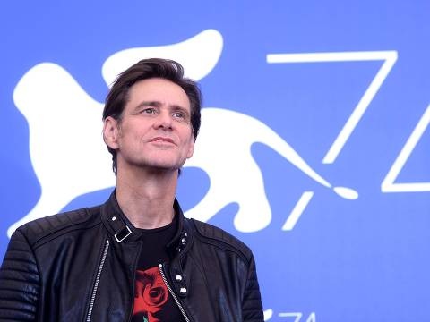 """(FILES) In this file photo taken on September 5, 2017 actor Jim Carrey attends the photocall of the movie """"Jim & Andy: The Great Beyond - The Story Of Jim Carey & Andy Kaufman With A Very Special, Contractually Obligated Mention Of Tony Clifton"""" presented out of competition at the 74th Venice Film Festival at Venice Lido.  Veteran comic actor Jim Carrey has been spared the prospect of civil trial over the suicide of his girlfriend Cathriona White, his representative said on February 1, 2018, after the case was dismissed. White's estranged husband Mark Burton and mother Brigid Sweetman had filed a wrongful death lawsuit against the star following her overdose in September 2015, accusing him of procuring drugs under a bogus name for her.They also alleged that the 56-year-old actor -- known for a string of hit comedy movies including """"The Mask,"""" """"Liar Liar"""" and """"Ace Ventura: Pet Detective"""" -- had given White three sexually-transmitted diseases.  / AFP PHOTO / Filippo MONTEFORTE"""