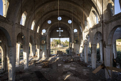 A destroyed Christian church near Tal Tamer, Syria, June 9, 2018. This village, and others like it in Syria?s northeast that were home to Assyrian Christians, are now largely abandoned. Many residents had already migrated before the rise of the Islamic State group, which ransomed off or killed those who remained. (Ivor Prickett/The New York Times) ORG XMIT: XNYT43