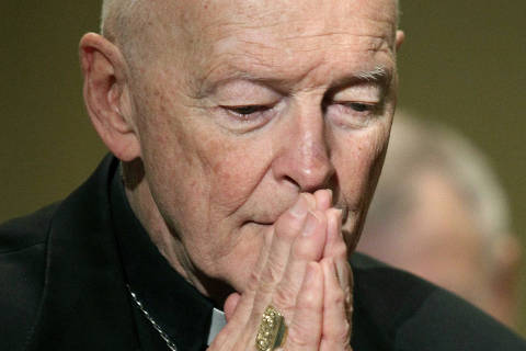 FILE - In this Nov. 14, 2011 file photo, Cardinal Theodore McCarrick prays during the United States Conference of Catholic Bishops' annual fall assembly in Baltimore. The president of the U.S. Conference of Catholic Bishops said Wednesday, Aug. 1, 2018, that sex abuse allegations against the ex-Cardinal dating back decades raise serious questions about how the alleged abuse remained a secret for so long. (AP Photo/Patrick Semansky, File) ORG XMIT: PDX314