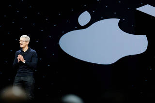 FILE PHOTO: Apple Chief Executive Officer Tim Cook speaks at the Apple Worldwide Developer conference (WWDC) in San Jose