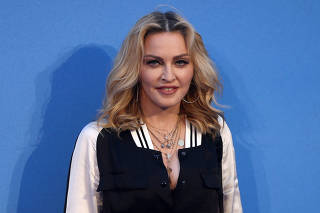 FILE PHOTO: U.S. singer Madonna attends the world premiere of 'The Beatles: Eight Days a Week - The Touring Years' in London