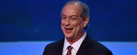 Brazilian presidential candidate Ciro Gomes (PDT) gestures during the first presidential debate ahead of the October 7 general election, at Bandeirantes television network in Sao Paulo, Brazil, on August 9, 2018. (Photo by Nelson ALMEIDA / AFP)