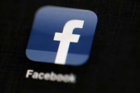 FILE - In this May 16, 2012, file photo, the Facebook logo is displayed on an iPad in Philadelphia. Intelligence officials warn that foreign adversaries continue to wage cyber warfare against the U.S. election systems. But with the midterm elections just three months away, political campaigns report that they?re largely on their own in the increasingly challenging task of protecting sensitive information and countering false or misleading content on social media.  (AP Photo/Matt Rourke, File) ORG XMIT: WX202
