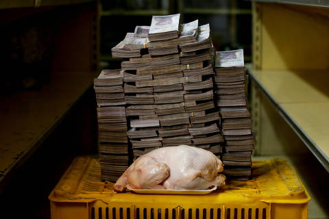 A 2.4 kg chicken is pictured next to 14,600,000 bolivars, its price and the equivalent of 2.22 USD, at a mini-market in Caracas, Venezuela August 16, 2018. It was the going price at an informal market in the low-income neighborhood of Catia. REUTERS/Carlos Garcia Rawlins    SEARCH