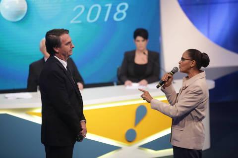 Bolsonaro e Marina têm confronto sobre direitos da mulher e elevam tensão em debate