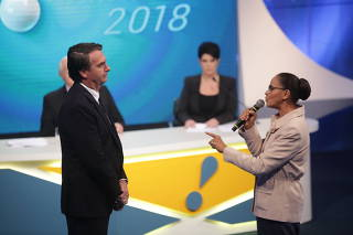 Marina Silva (Rede) confronta Jair Bolsonaro (PSL) durante debate