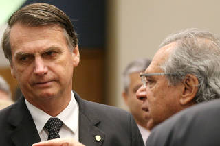 Federal deputy Bolsonaro a candidate for the Presidency of the Republic for the PSL listens to economist Paulo Guedes before a lunch with businessmen at the FIRJAN headquarter in Rio de Janeiro