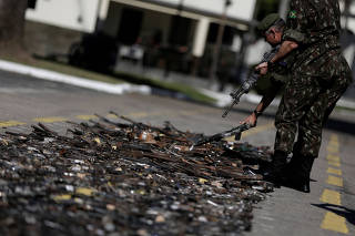 Brazilian military, check guns seized from criminals by the armed forces before being destroyed in Rio de Janeiro