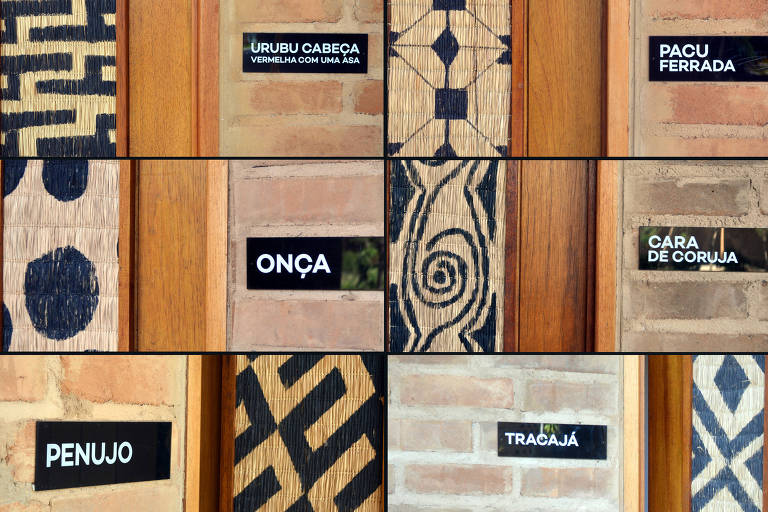 Placas com grafismos indígenas coladas nas paredes de tijolos de escola