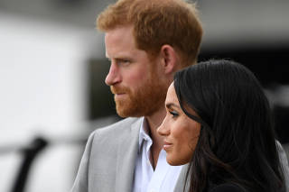 FILE PHOTO: Britain's Prince Harry and Meghan, the Duchess of Sussex, visit the Famine Memorial in Dublin