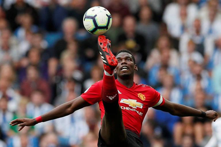 95e59ac3bd O meio-campista Paul Pogba em ação pelo Manchester United