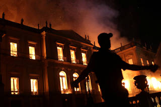 A policeman clears the area during a fire at the National Museum of Brazil in Rio de Janeiro