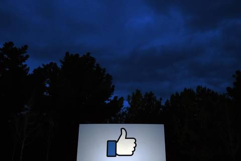 (FILES) In this file photo taken on March 21, 2018 a lit sign is seen at the entrance to Facebook's corporate headquarters location in Menlo Park, California. - Facebook said Wednesday, August 29, 2018, it is rolling out globally its Watch video service, which has already been available in the United States for more than a year. Facebook launched Watch amid a shift in video viewing habits away from traditional television to online platforms including Netflix and Hulu, and with more people watching both professional and user content on services like YouTube. (Photo by JOSH EDELSON / AFP)
