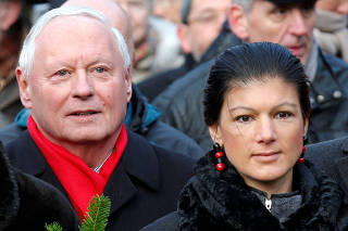 FILE PHOTO: Members of German left-wing party Die Linke Lafontaine and Wagenknecht attend a wreath laying ceremony at the Monument for the Socialists in Berlin