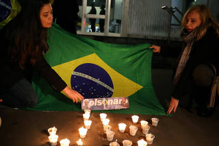 People light candles for presidential candidate Jair Bolsonaro after he was stabbed by a man in Juiz de Fora at Paulista avenue in Sao Paulo