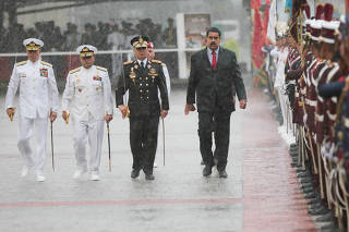 Venezuela's President Nicolas Maduro arrives at a military parade for the transmission of Air Force and Navy commands in Caracas