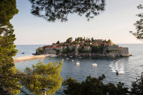 The Aman Sveti Stefan resort in Montenegro on Aug. 4, 2018.  In the 1970s, celebrities like Elizabeth Taylor and Sophia Loren vacationed at Sveti Stefan, a peninsular village-turned-luxury-resort, now run by Aman hotels and still favored by the glitterati.  (Susan Wright/The New York Times) ORG XMIT: XNYT194