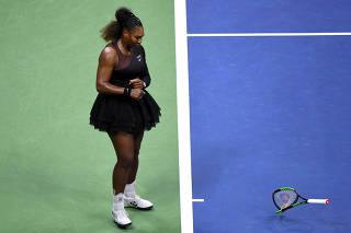 FILE PHOTO: Serena Williams of the United States smashes her racket on day thirteen of the 2018 U.S. Open tennis tournament in New York