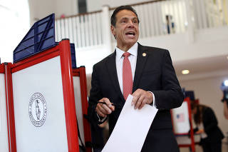 New York Governor Andrew Cuomo holds his ballot while voting in the New York Democratic primary election at the Presbyterian Church in Mt. Cisco