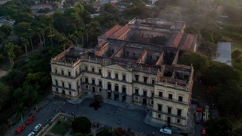 Drone view of Rio de Janeiro's treasured National Museum, one of Brazil's oldest, with the Maracana stadium in the background, on September 3, 2018, a day after a massive fire ripped through the building. - The majestic edifice stood engulfed in flames as plumes of smoke shot into the night sky, while firefighters battled to control the blaze that erupted around 2230 GMT. Five hours later they had managed to smother much of the inferno that had torn through hundreds of rooms, but were still working to extinguish it completely, according to an AFP photographer at the scene. (Photo by Mauro Pimentel / AFP)