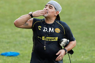 Argentinian soccer legend Diego Armando Maradona reacts to fans during his first training session as coach of Dorados at the Banorte stadium in Culiacan, in the Mexican state of Sinaloa