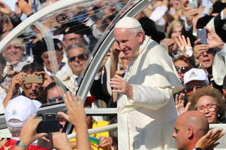Pope Francis arrives to celebrate a holy mass in Palermo