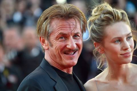 (FILES) In this file photo taken on May 20, 2016 US actor and director Sean Penn (L) smiles as he arrives with his daughter US actress Dylan Penn for the screening of the film