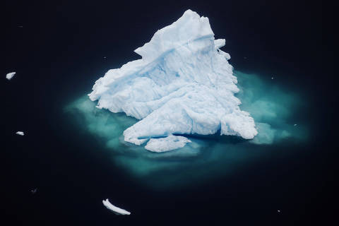An iceberg floats in a fjord near the town of Tasiilaq, Greenland, June 24, 2018. REUTERS/Lucas Jackson  SEARCH