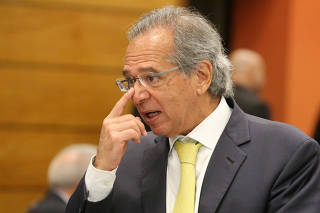 FILE PHOTO: Economist Guedes is seen before a lunch between businessmen and Federal deputy Bolsonaro a candidate for the Presidency of the Republic for the PSL at the FIRJAN HQ in Rio de Janeiro