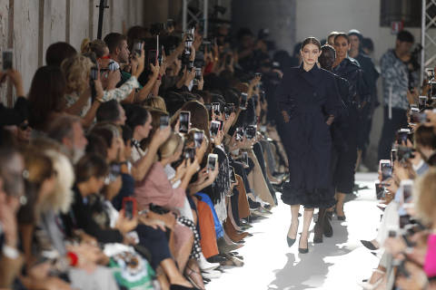 Model Gigi Hadid, front, leads other models as they wear creations as part of the Max Mara women's 2019 Spring-Summer collection, unveiled during the Fashion Week in Milan, Italy, Thursday, Sept. 20, 2018. (AP Photo/Antonio Calanni) ORG XMIT: LENT113