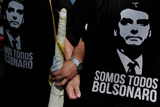 FILE PHOTO: Supporters of presidential candidate Jair Bolsonaro attend a rally for vice presidential candidate Hamilton Mourao in Manaus