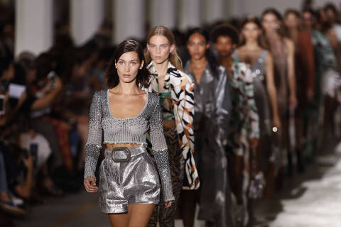 Model Bella Hadid leads other models as part of the Cavalli women's 2019 Spring-Summer collection, unveiled during the Fashion Week in Milan, Italy, Saturday, Sept. 22, 2018. (AP Photo/Antonio Calanni) ORG XMIT: LENT113