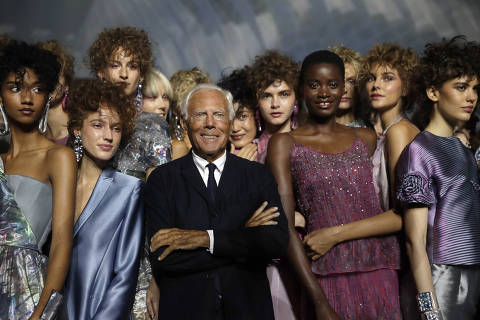 Designer Giorgio Armani, centre, poses with models at the end of his women's 2019 Spring-Summer collection, unveiled during the Fashion Week in Milan, Italy, Sunday, Sept. 23, 2018. (AP Photo/Luca Bruno) ORG XMIT: LENT133