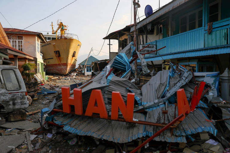 A ship is seen stranded on the shore after the earthquake and tsunami hit an area in Donggala