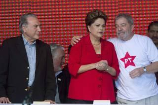 Brazil's President Dilma Rousseff stands with her predecessor Luiz Inacio Lula da Silva and Brazil's Vice President Michel Temer at the PT national convention in Brasilia