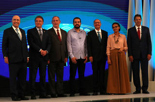 Presidential candidates pose ahead of a televised debate in Rio de Janeiro