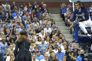 Serena Williams argues with Carlos Ramos during her match with Naomi Osaka at the U.S. Open women's final in New York.