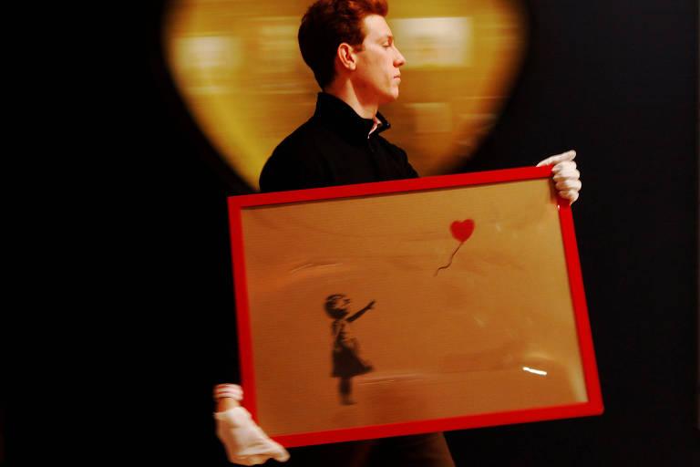 Obra 'Girl and Balloon' de  2009,  durante uma venda em Londres