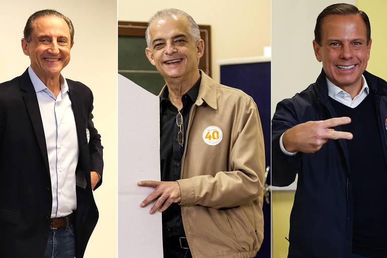 Paulo Skaf (MDB), Márcio França (PSB) e João Doria (PSDB) durante votação neste domingo (7)