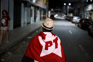 A supporter of Fernando Haddad, presidential candidate of BrazilÕs leftist Worker Party (PT), walks in Fortaleza