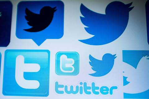 (FILES) In this file photo illustration taken on March 23, 2018 shows Twitter logos on a computer screen in Beijing. - Twitter on September 25, 2018 reached out to users for help crafting a ban on comments that dehumanize people and set the stage for real-world violence. A policy change that Twitter has been working on for several months is intended to broaden hateful content restrictions at the service to include barring tweets dehumanizing people based on race, religion, sexual orientation or other social grouping. (Photo by NICOLAS ASFOURI / AFP) ORG XMIT: ASF1868