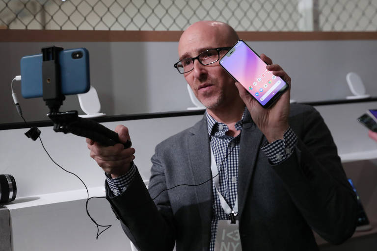 A man takes a video of the Google Pixel 3 third generation smartphone after a news conference in Manhattan, New York