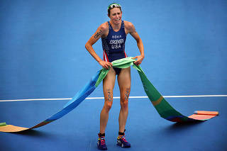 Gwen Jorgensen of the U.S. wins the gold medal for the women's individual triathlon at Fort Copacabana during the 2016 Summer Olympics in Rio de Janeiro.