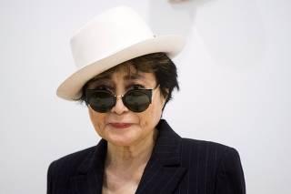 File photo of artist Yoko Ono standing in the exhibit