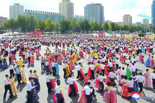 People celebrate the 73rd anniversary of the founding of the Korean Workers' Party in this photo released by North Korea's Korean Central News Agency