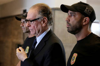 Brazilian Olympic Committee (COB) President Carlos Arthur Nuzman leaves the Federal Police headquarters heading to jail, in Rio de Janeiro