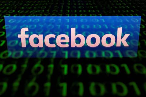 (FILES) A file illustration picture taken on April 28, 2018 shows the logo of social network Facebook displayed on a screen and reflected on a tablet in Paris. - Facebook on Tuesday October 2, 2018 said hackers who stole digital keys to tens of millions of accounts appear not to have tampered with third-party applications linked to the social network. (Photo by Lionel BONAVENTURE / AFP)