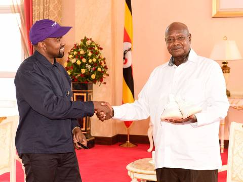 "A handout photo released by Uganda's presidential press office on October 15, 2018 shows Uganda's President Yoweri Museveni (R) meeting with US rapper Kanye West at the State House in Entebbe, Uganda. (Photo by - / Uganda's Presidential press office / AFP) / RESTRICTED TO EDITORIAL USE - MANDATORY CREDIT ""AFP PHOTO / HO / UGANDA'S PRESIDENTIAL PRESS OFFICE"" - NO MARKETING - NO ADVERTISING CAMPAIGNS - DISTRIBUTED AS A SERVICE TO CLIENTS"